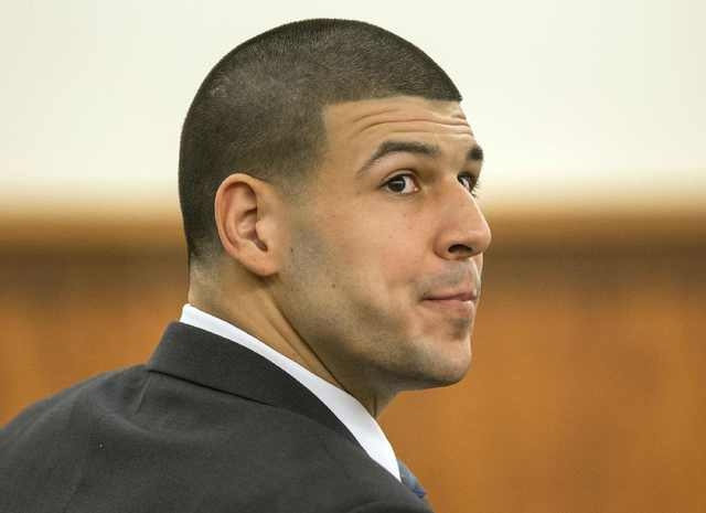 Former New England Patriots football player Aaron Hernandez listened to testimony during his murder trial in Fall River, Massachusetts March 17, 2015.  Hernandez is charged with killing semi-profe ...