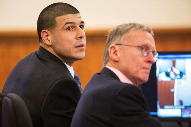 Aaron Hernandez sits with his attorney Charles Rankin during his murder trial at the Bristol County Superior Court in Fall River, Massachusetts, March 17, 2015. (REUTERS/Aram Boghosian/Pool)