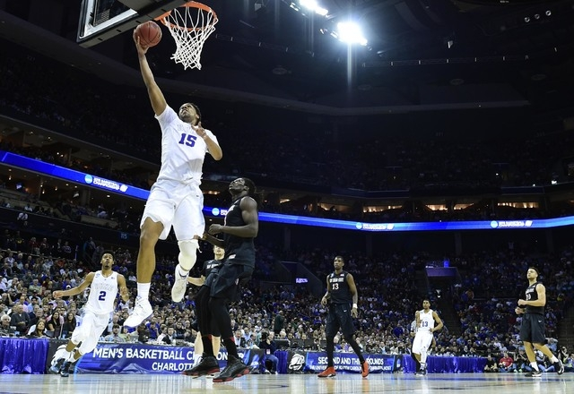 Mar 22, 2015; Charlotte, NC, USA; Duke Blue Devils center Jahlil Okafor (15) shoots the ball against San Diego State Aztecs forward Angelo Chol (3) during the first half in the third round of the  ...