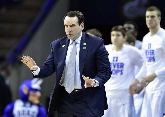 Duke Blue Devils head coach Mike Krzyzewski reacts during the second half against the San Diego State Aztecs in the third round of the 2015 NCAA Tournament at Time Warner Cable Arena in Charlotte, ...