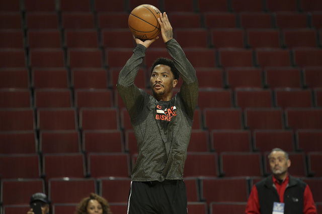 Mar 23, 2015; Chicago, IL, USA; Chicago Bulls guard Derrick Rose (1) shoots before the NBA game against the Charlotte Hornets at United Center. (Kamil Krzaczynski-USA TODAY Sports)