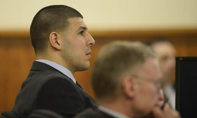 Former NFL player Aaron Hernandez listens during his murder trial in Fall River, Massachusetts  March 27, 2015.  Hernandez is accused of the June 2013 killing of semi-professional football player  ...