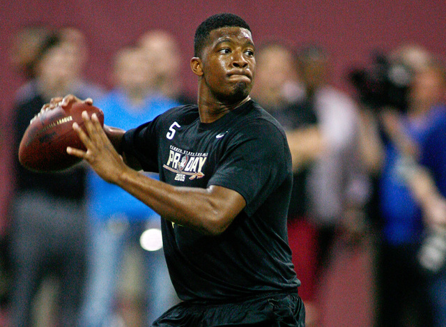 Mar 31, 2015; Tallahassee, FL, USA; Florida State Seminoles quarterback Jameis Winston throws during FSU Football Pro Day at the Albert J. Dunlap Athletic Training Facility. Mandatory Credit: Phil ...