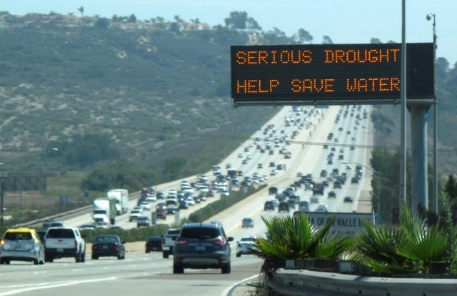 A digital traffic sign usually used for commuter travel information informs travelers southbound on interstate highway 5 to conserve water as they pass through Del Mar, California September 10, 20 ...