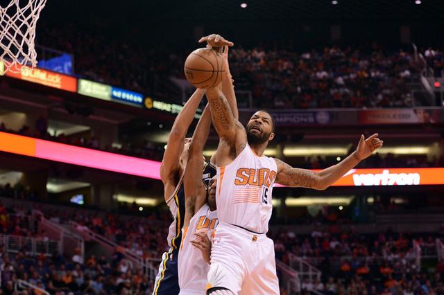 Apr 4, 2015; Phoenix, AZ, USA; Phoenix Suns forward Marcus Morris (15) pulls down a rebound over Utah Jazz center Rudy Gobert (27) and Phoenix Suns forward Brandan Wright (32) during the first hal ...
