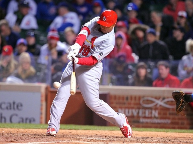 Apr 5, 2015; Chicago, IL, USA; St. Louis Cardinals center fielder Jon Jay (19) his a double during the eighth inning against the Chicago Cubs at Wrigley Field. St. Louis won 3-0. (Dennis Wierzbick ...