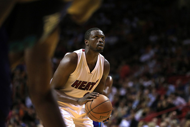 Apr 7, 2015; Miami, FL, USA; Miami Heat forward Luol Deng (9) shoots a foul shot in the second half of a game against the Charlotte Hornets at American Airlines Arena. The Heat won 105-100. (Rober ...