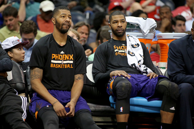 Apr 7, 2015; Atlanta, GA, USA; Phoenix Suns forward Markieff Morris (left) and forward Marcus Morris (15) are shown on the bench in the fourth quarter of their game against the Atlanta Hawks at Ph ...