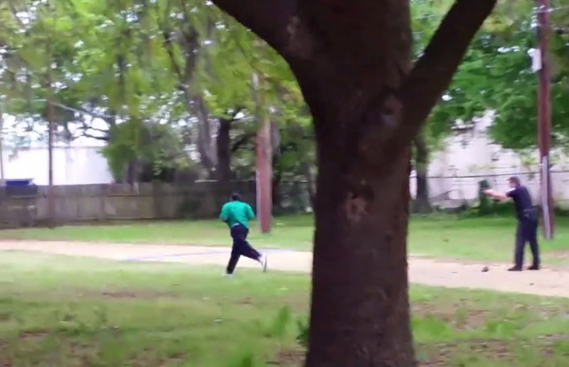 North Charleston police officer Michael Slager (R) is seen allegedly shooting 50-year-old Walter Scott in the back as he runs away, in this still image from video in North Charleston, South Caroli ...