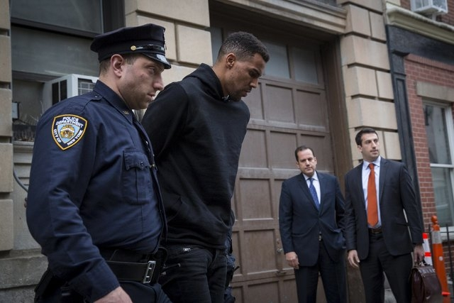 NBA player Thabo Sefolosha, 30, of the Atlanta Hawks is seen escorted out of the 10th Precinct of the New York Police Department (NYPD) in Manhattan, New York April 8, 2015.  NBA player Chris Cope ...