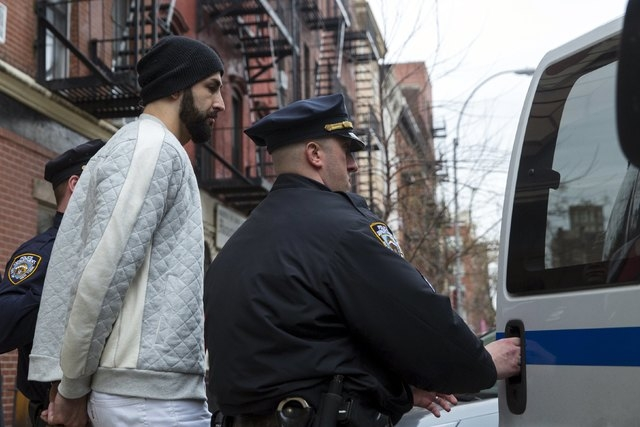 NBA player Pero Antic, 33, of the Atlanta Hawks is seen escorted out of 10th Precinct of the New York Police Department (NYPD) in Manhattan, New York April 8, 2015. NBA player Chris Copeland of th ...