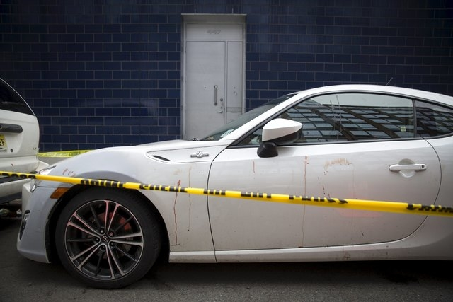 Blood is smeared on a car near the 1 Oak nightclub in New York on April 8, 2015. NBA player Chris Copeland of the Indiana Pacers and his wife were stabbed during a dispute outside a New York City  ...