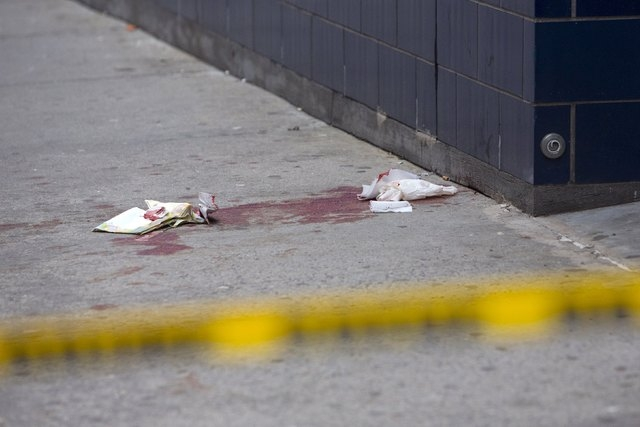 Blood is seen on the sidewalk near the 1 Oak nightclub in New York on April 8, 2015.  NBA player Chris Copeland of the Indiana Pacers and his wife were stabbed during a dispute outside a New York  ...