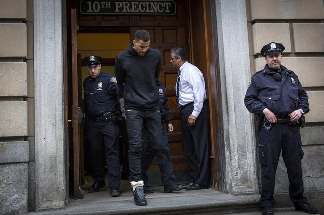 NBA player Thabo Sefolosha, 30, of the Atlanta Hawks is seen escorted out of the 10th Precinct of the New York Police Department (NYPD) in Manhattan, New York April 8, 2015. NBA player Chris Copel ...