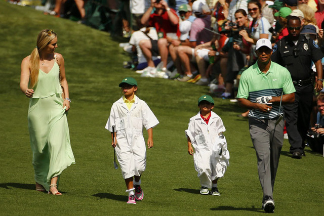 U.S. golferTiger Woods walks down the fairway with his children Sam (2nd from L) and Charlie and his girfriend Lindsey Vonn during the par 3 event held ahead of the 2015 Masters at Augusta Nationa ...