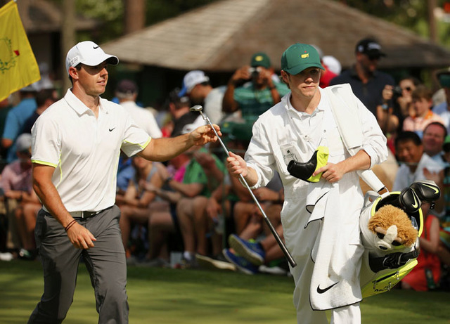 One Direction singer Niall Horan (R) caddies for Rory McIlroy of Northern Ireland during the par 3 event held ahead of the 2015 Masters at Augusta National Golf Course in Augusta, Georgia April 8, ...