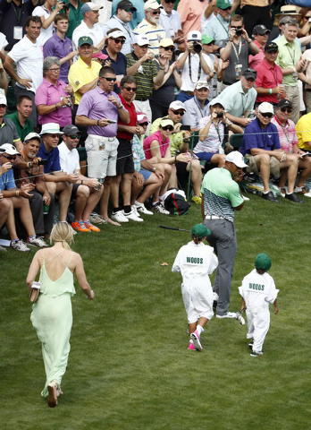 Apr 8, 2015; Augusta, GA, USA; Tiger Woods and his children Sam Woods and Charlie Woods and girlfriend Lindsey Vonn walk to the 8th hole during the Par 3 Contest prior to the 2015 The Masters golf ...