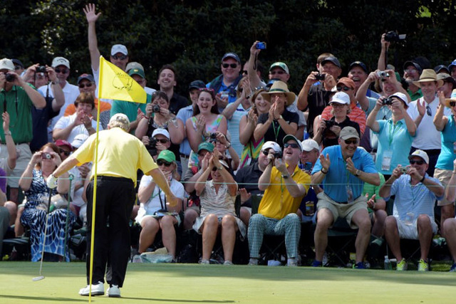 Apr 8, 2015; Augusta, GA, USA; Jack Nicklaus takes a bow for the gallery on the 3rd green during the Par 3 Contest prior to the 2015 The Masters golf tournament at Augusta National Golf Club.  Mic ...