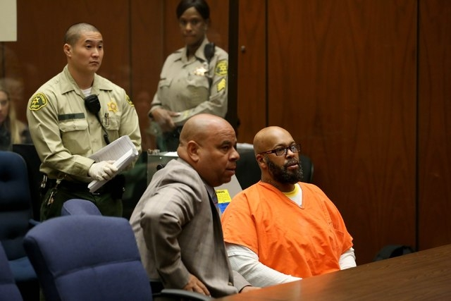 "Rap mogul Marion ""Suge'' Knight, right, appears in court with his lawyer Matthew P. Fletcher, center, in Los Angeles on April 8, 2015, on charges that he and comedian Micah ""Katt"" Williams stole a ..."