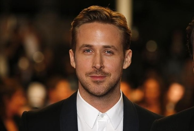 """Director Ryan Gosling poses on the red carpet as he arrives for the screening of the film """"Lost River"""" in competition for the category """"Un Certain Regard"""" at the 67th Cannes Film Festival in Canne ..."""
