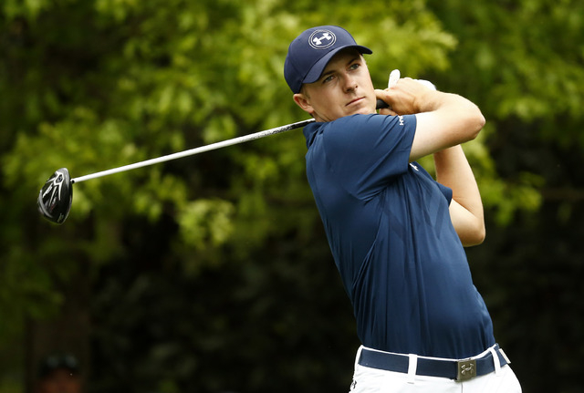 Apr 12, 2015; Augusta, GA, USA; Jordan Spieth hits his tee shot on the 7th hole during the final round of The Masters golf tournament at Augusta National Golf Club. (Rob Schumacher-USA TODAY Sports)