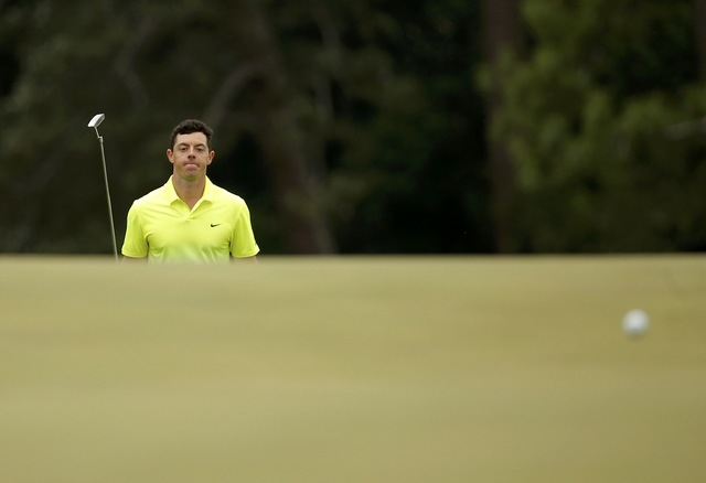 Rory McIlroy of Northern Ireland walks up to the 18th green during the final round of the Masters golf tournament at the Augusta National Golf Course in Augusta, Georgia April 12, 2015. (REUTERS/B ...