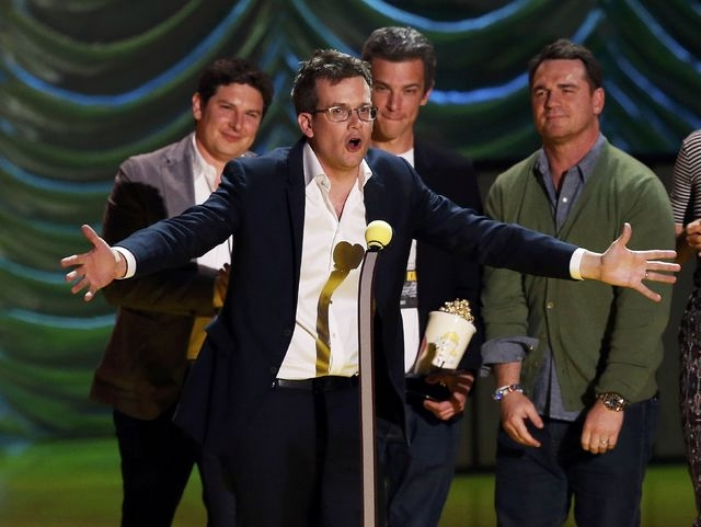 "Writer John Green and the cast of ""The Fault with Our Stars"" accept the award for Movie of the Year during the 2015 MTV Movie Awards in Los Angeles, California April 12, 2015. (REUTERS/Mario Anzuoni)"