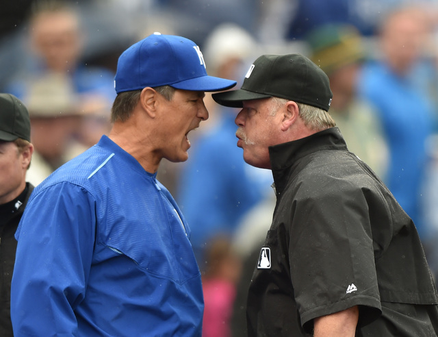Apr 19, 2015; Kansas City, MO, USA; Kansas City Royals bench coach Don Wakamatsu (left) argues with crew chief Jim Joyce (right) after pitcher Kelvin Herrera (not pictured) was ejected from the ga ...