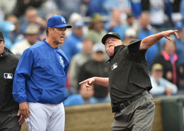 Apr 19, 2015; Kansas City, MO, USA; Kansas City Royals bench coach Don Wakamatsu (left) is ejected from the game by crew chief Jim Joyce (right) after pitcher Kelvin Herrera (not pictured) was als ...