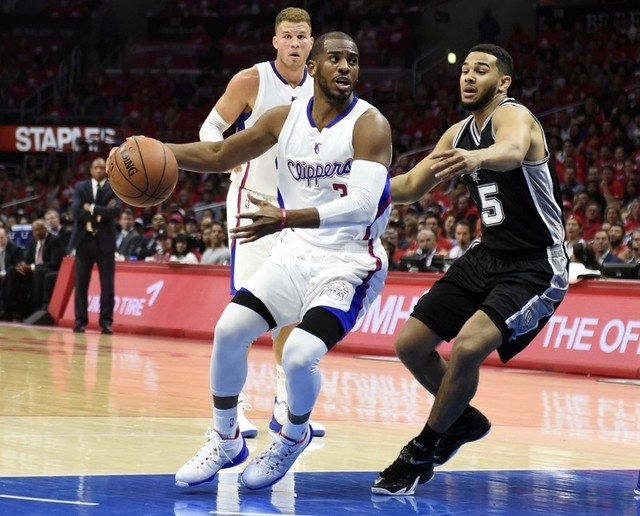 Apr 19, 2015; Los Angeles, CA, USA; Los Angeles Clippers guard Chris Paul (3) drives to the basket against San Antonio Spurs guard Cory Joseph (5) during the first quarter in game one of the first ...
