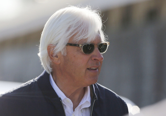 Horse trainer Bob Baffert talks with media and spectators during morning work outs at Churchill Downs. (Mark Zerof-USA TODAY Sports)
