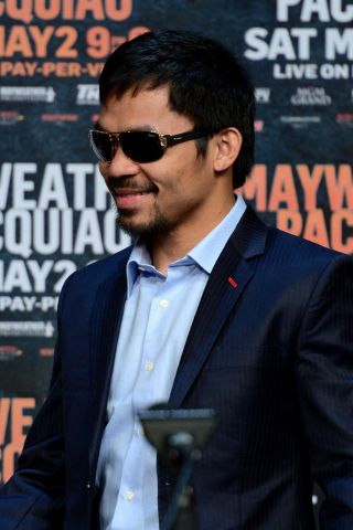 Apr 29, 2015; Las Vegas, NV, USA; Manny Pacquiao looks on during a press conference at KA Theatre. (Joe Camporeale-USA TODAY Sports)