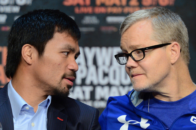 Apr 29, 2015; Las Vegas, NV, USA; Manny Pacquiao and trainer Freddie Roach talk during a press conference at KA Theatre. (Joe Camporeale-USA TODAY Sports)