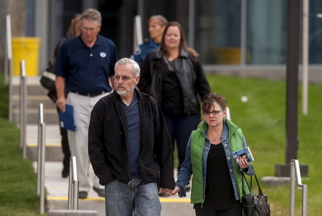 Victims and family members of victims leave Arapahoe County District Court in Centennial, Colorado, April 27, 2015. (Reuters/Evan Semon)