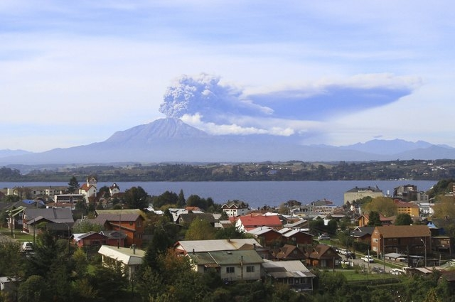 A general view shows Calbuco volcano spewing ash and smoke from Puerto Varas, Chile, April 30, 2015. Chilean volcano Calbuco, which erupted twice last week, began sending a new cloud of ash and ga ...