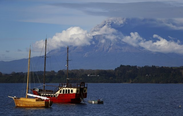 A general view of Calbuco volcano spewing ash and smoke from Puerto Varas, April 30, 2015. Chilean volcano Calbuco, which erupted twice last week, began sending a new cloud of ash and gas high int ...