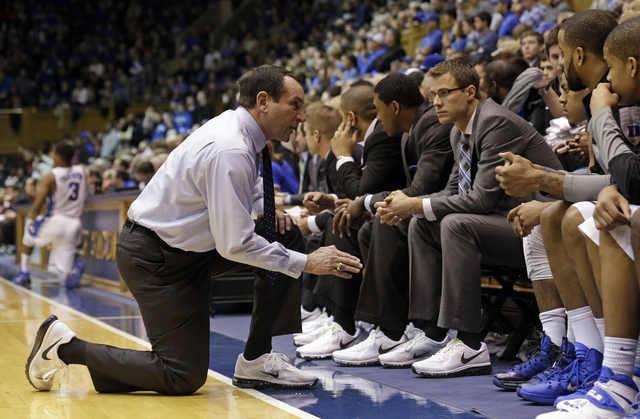 Duke coach Mike Krzyzewski speaks with his players during the second half of an NCAA college basketball game against Florida State in Durham, North Carolina, Saturday, Jan. 25, 2014. Duke won 78-5 ...