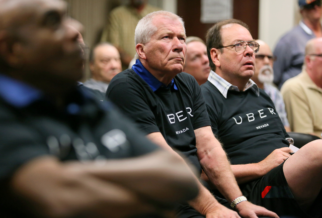 Uber supporters Tom Gruenewald, center, and Paul Servizi, right, attend a legislative hearing at Grant Sawyer Building Monday, March 30, 2015, in Las Vegas. Southern Nevada taxi drivers and Uber s ...