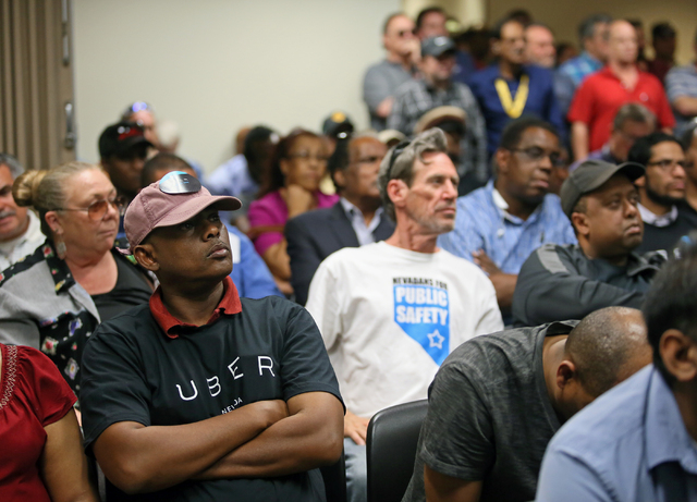 People attend a legislative hearing at Grant Sawyer Building Monday, March 30, 2015, in Las Vegas. Southern Nevada taxi drivers and Uber supporters were among those who attended a hearing to discu ...