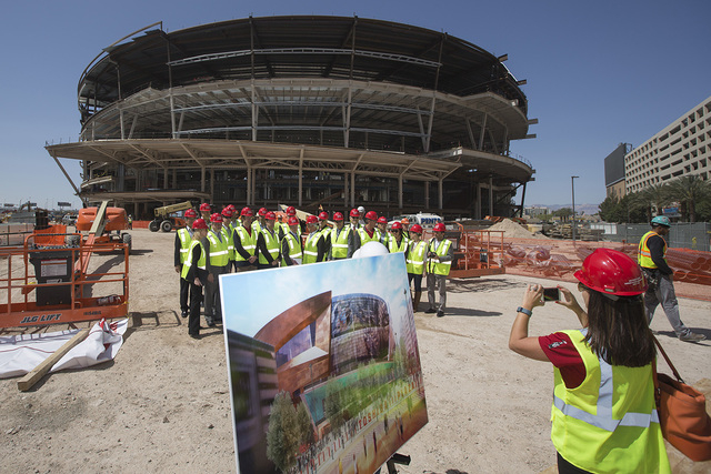 Officials gather for a photo during a naming announcement at site of the new arena under construction behind New York-New York on Tuesday, April 7, 2015. The two-acre public area outside the arena ...
