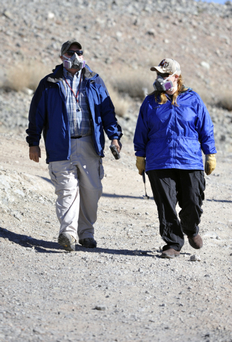 UNLV professors, Rodney Metcalf, Ph.d, Geology and Brenda Buck, Ph.d., Soil Science walk in the desert after examiinge rocks for naturally occurring asbestos, Saturday, Dec., 21 2013 in southeaste ...