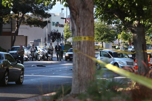 Metro investigates the scene of an accident involving a PT Cruiser and a pedestrian on Jones Boulevard near Vegas Drive Wednesday, April 8, 2015. (Sam Morris/Las Vegas Review-Journal) Follow Sam M ...