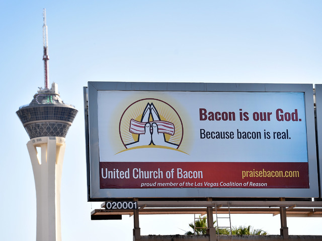 A billboard in support of the United Church of Bacon is seen along Las Vegas Boulevard near Charleston Boulevard on Monday, April 13, 2015. John Whiteside, who founded the United Church of Bacon,  ...