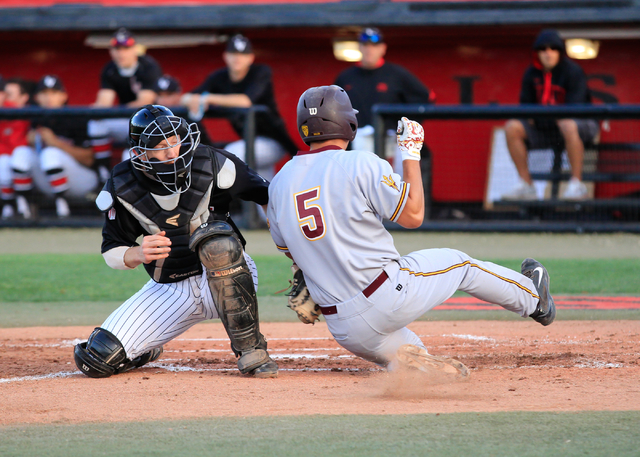 Arizona State senior Joey Bielek (5) slides into home plate while UNLV senior Erik VanMeetren (8) attempts to tag him out during a baseball game at Wilson Stadium on the UNLV campus, in Las Vegas  ...