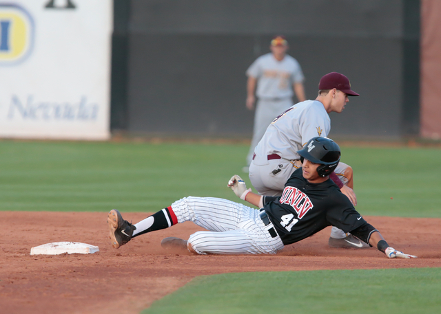 UNLV freshman Nick Rodriguez (41) slides into second base being covered by Arizona State freshman Andrew Snow (4) during a baseball game against the Arizona State Sun Devils at Wilson Stadium on t ...