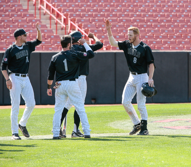 UNLV Rebels senior Erik VanMeetren (8) right, celebrates as his teammates greet him after hitting a home run during a baseball game with the UNLV Rebels against the University of New Mexico Lobos  ...