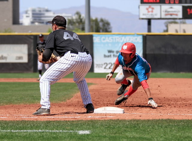University of New Mexico senior  Aaron Siple (21) dives back to first base to avoid being tagged out by UNLV Rebels senior Morgan Stotts (44) during a baseball game with the UNLV Rebels against th ...
