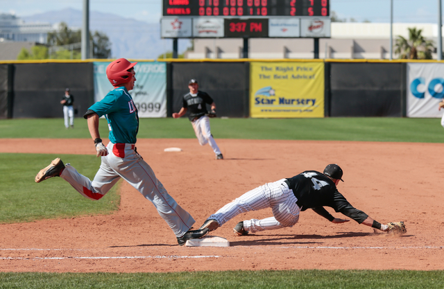 University of New Mexico freshman Hayden Schilling (3) left, steps on the bag at first base, as UNLV Rebels senior Morgan Stotts (44) stretches for a wide throw, during a baseball game with the UN ...