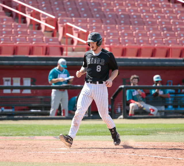 UNLV Rebels senior Erik VanMeetren (8) crosses home plate after hitting a home run during a baseball game with the UNLV Rebels and the University of New Mexico Lobos at Wilson Stadium on the UNLV  ...