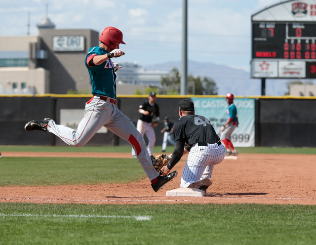 University of New Mexico freshman Carl Stajduhar (30), attempts to beat a ball to first base being covered by UNLV Rebels senior Morgan Stotts (44), during a baseball game with the UNLV Rebels aga ...